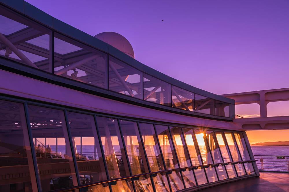 Sonnenuntergang beim Auslaufen der Rhapsody of the Seas in Barcelona